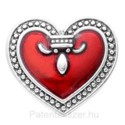 Piros fém szívpatent